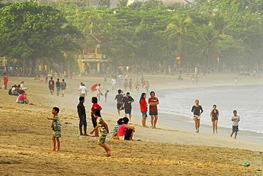 Local people at Kuta beach in the morning, Kuta, Bali, Indonesia, Asia