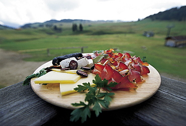 A board with ham and cheese, view at an alp, South Tyrol, Italy, Europe