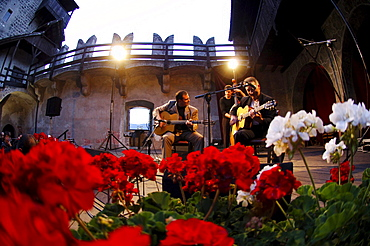 Two musicians playing the guitar at the atrium of Runkelstein castle, Bolzano, South Tyrol, Italy, Europe
