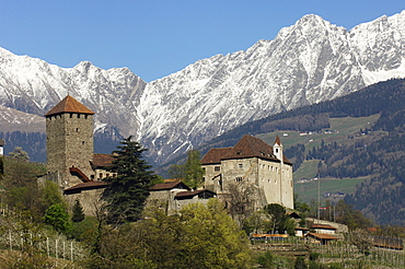 Tyrol castle in spring in front of snow covered mountains, Burggrafenamt, Etsch valley, South Tyrol, Italy, Europe