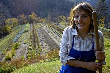 Martha Mulser in her herbal garden, Medicinal herbs, plants, organic farming, herbal farm, Pflegerhof Martha Mulser, Seis am Schlern, Schlern, South Tyrol, Italy