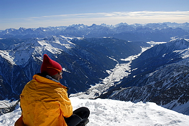 Man enjoying the views into the valley, Antholz valley, Puster valley, South Tyrol, Italy