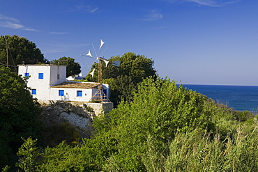 Villa, house on the coast with windmill, Akamas Nature Reserve Park, South Cyprus, Cyprus
