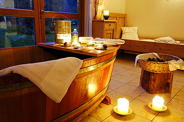 Wooden bathtub and candles at the spa of Hotel Bad Schoergau, Bad Schoergau, Valley Sarntal, South Tyrol, Italy, Europe