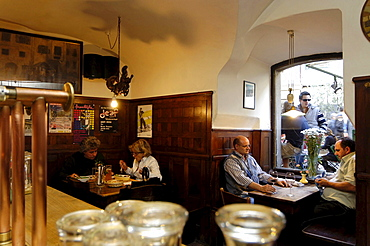 People sitting in the dining area of the brewery Hopfen & Co., Bozen, South Tyrol, Italy, Europe