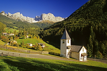 San Cipriano chapel, view to Cima Catinaccio, Dolomite Alps, South Tyrol, Italy