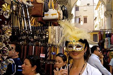 Tourist with mask at Mercato del Porcellino, Loggia del Mercato Nuevo, Florence, Tuscany, Italy, Europe