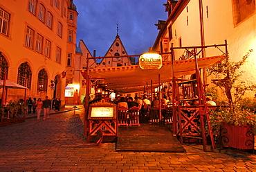 Tables outside the Olde Hansa Restaurant, which serves medievel dishes, evening, Tallinn, Estonia