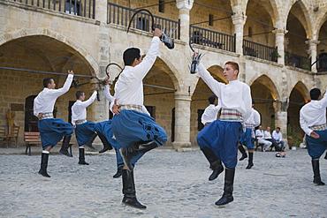 A group of male folk dancers in traditional costume, Buyuk Han, The Great Inn, Ottoman caravansary, Lefkosia, Nicosia, North Cyprus, Cyprus
