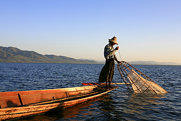 Intha fisherman with fish trap in the evening light, Inle Lake, Shan State, Myanmar, Burma, Asia