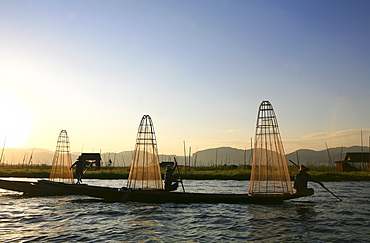 Intha fishermen with fish traps in the evening light, Inle Lake, Shan State, Myanmar, Burma, Asia