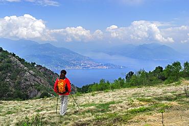 Woman looking at lake Maggiore with Verbania, Mottarone, Stresa, lake Maggiore, Piemont, Italy