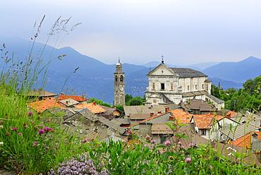 Spire and church above the roofs of Viggiona, Viggiona, Cannero, lake Maggiore, Lago Maggiore, Piemont, Italy