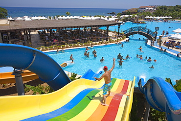 Young man on a water slide, water park, Acapulco Beach Club and Resort Hotel, 10km east of Kyrenia, Girne, Keryneia, Cyprus