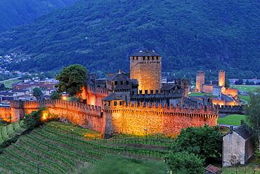 Illuminated castle Castello di Montebello and castle Castelgrande in background in UNESCO World Heritage Site Bellinzona, Bellinzona, Ticino, Switzerland