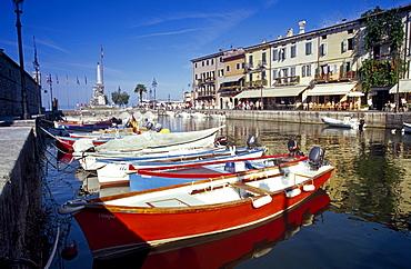 Fishing boats at harbour in the sunlight, Lazise, Lake Garda, Veneto, Italy, Europe