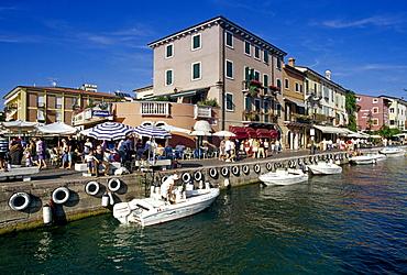 Motor boats at harbour under blue sky, Lazise, Lake Garda, Veneto, Italy, Europe