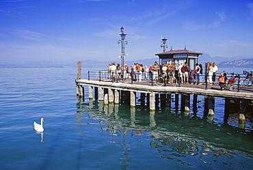 People standing on the landing stage waiting, Lazise, Lake Garda, Veneto, Italy, Europe