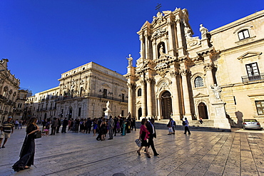 People visiting cathedral, Syracuse, Ortygia island, Sicily, Italy