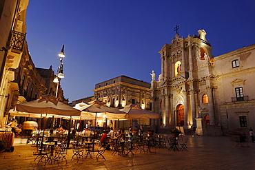 Place Cathedral with pavement cafe and cathedral in the evening, Syracuse, Ortygia island, Sicily, Italy