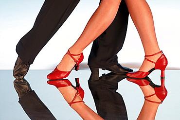 Legs of tango dancers