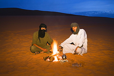 tuaregs preparing tea at campfire, Libya, Africa