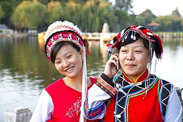 Portrait of two Chinese women wearing traditional costumes, Bai minority, Dianchi Lake, Daguan Park, north-west of Kunming City, Kunming, Yunnan, People's Republic of China, Asia