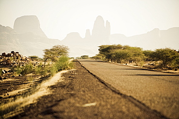 Empty road in the sunlight in front of Hand of Fatima, Mali, Africa