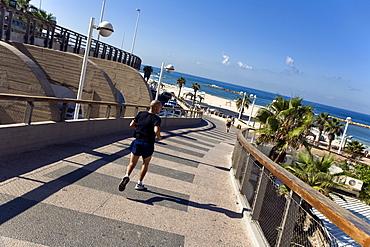 Jogger on the Tayelet seaside promenade, Gordon Beach, Tel Aviv, Israel, Middle East