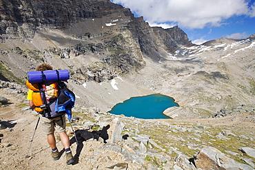 Man hiking near Lago Lillet, Alta Via del Canavese, Gran Paradiso National Park, Piedmont, Italy