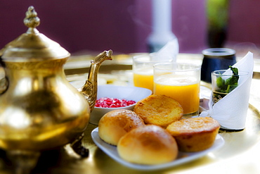 Moroccan breakfast with peppermint tea and orange juice, Riad Kaiss, Marrakech, Morocco, Africa