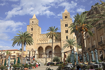 People at San Salvatore Cathedral at the square Piazza Duomo in Cefalu, Province Palermo, Sicily, Italy