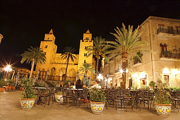 People at a restaurant in front of San Salvatore Cathedral at the square Piazza Duomo at night, Cefalu, Province Palermo, Sicily, Italy, Europe