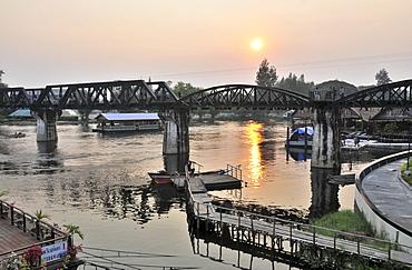 Railwaybridge over Kwai river at sunset, Kanchanaburi, Thailand, Asia