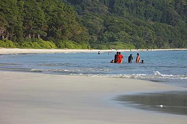Local girls wearing saris at Radha Nagar Beach, Beach 7, Havelock Island, Andamans, India