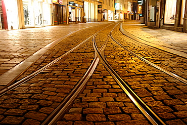 Tram lines in the Old Town of Ghent at night, Flanders, Belgium