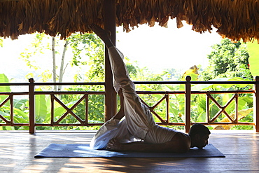 Indian yogi and yoga teacher at the Barefoot at Havelock Resort with a view across the rainforest, Radha Nagar Beach, Beach 7, Havelock Island, Andamans, India