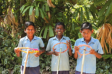 Boys in their school uniform playing car, Baratang, Middle Andaman, Andamans, India