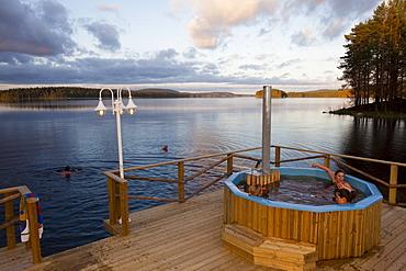 People at eco spa at lake of Trehoerningsjoe, Vaesternorrland, Sweden, Europe