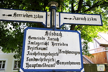 Old sign post, road sign, Altmuehltal cycle trail, Altmuehl valley, Hilsbach, Aurach, Bavaria, Germany