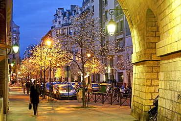 People and illuminated trees at the Viaduc des Arts, Paris, France, Europe