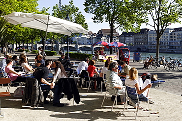 People at a cafe along the banks of the River Rhine, Riviera Klein-Basel, Basel, Switzerland