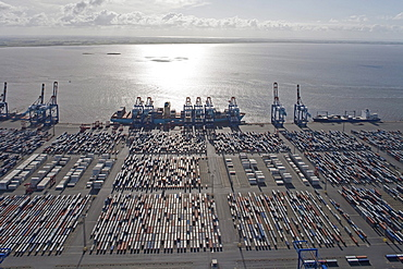 Aerial view of the container port, Containers and loading cranes in the backlight, Bremerhaven, northern Germany