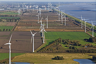 Aerial photo of a wind farm along the North Sea coast, farmland and Ems estuary, Emden, Lower Saxony, northern Germany