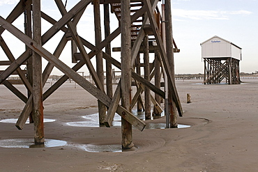Buildings on stilts, beach at low tide, St Peter-Ording, Schleswig-Holstein, North Sea coast, Germany