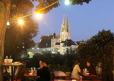 Old Linde beer garden in the evening, view to Regensburg Cathedral, Upper Palatinate, Bavaria, Germany