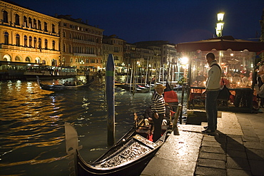Gondoliers with Gondols on Grand Canal at night, Venice, Veneto, Italy