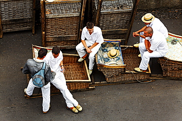 Wicker basket toboggans with their guides, sledges in Monte, Funchal, Madeira, Portugal