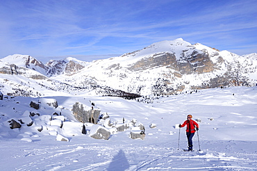 Woman backcountry skiing, ascending, Dolomite summits in the background, Fanes-Sennes natural park, UNESCO World Heritage Site, Dolomites, South Tyrol, Italy