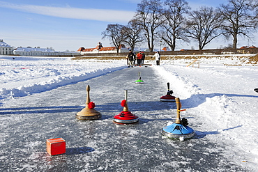 Group of people doing Bavarian curling, Nymphenburg castle in the background, Nymphenburg castle, Munich, Upper Bavaria, Bavaria, Germany